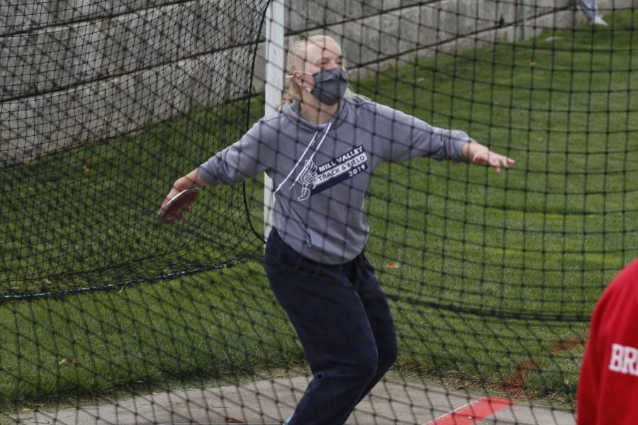 Ready for release, junior Elle Zars reaides herself to let go of the discus.