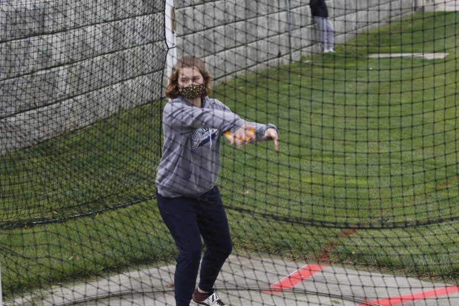 Turning behind her, senior Tyler Smith readies herself to launch the discus.