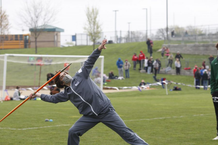 Leaned back, senior Dutch Platt aims his javelin.
