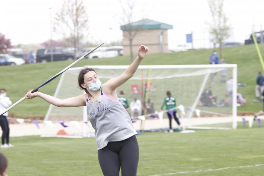 Looking afar, senior Carlie Bradshaw prepares to throw the javelin. Bradshaw placed 4th in the javelin throw with a distance of 98-7.