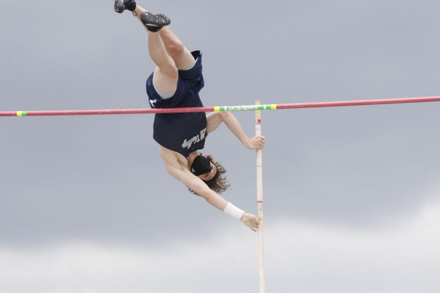 Clearing the rope, senior Garrett Beashore lets go of his pole. Beashore took 2nd place in pole vault clearing 13 feet.