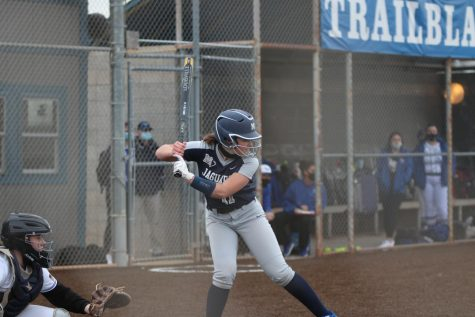Getting ready to swing her bat, sophomore Adisyn Hopkins waits for the ball.