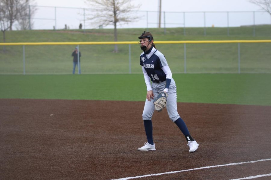 Standing ready at first base, freshman Elly VanRheen watches the batter get ready to hit.