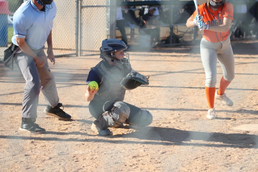 After catching the ball, sophomore Macee Moore throws the ball back to the pitcher.