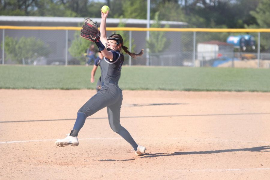 Winding her arm back, sophomore Anna Stottlemyre steps into the throw as she pitches the ball.