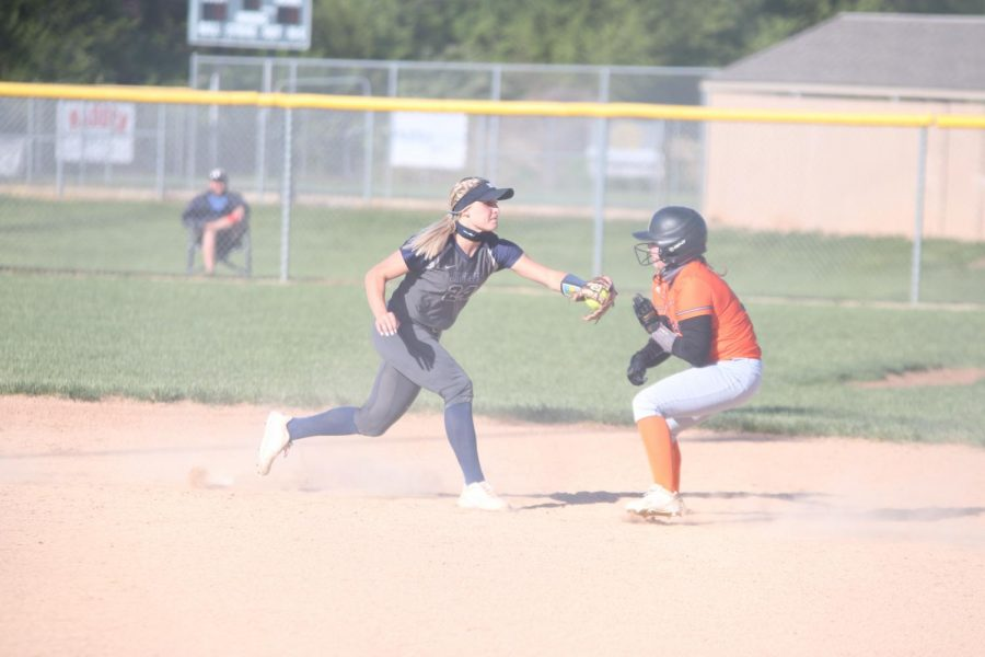 With the ball in hand senior Ava Bredwell lunges toward the opponent.