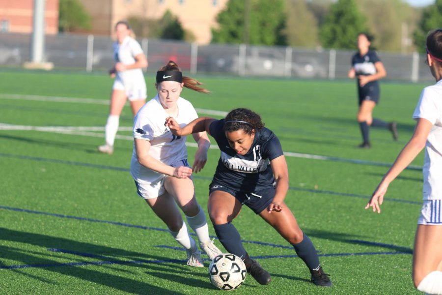 Eyes on the ball, sophomore Hadley Lockhart protects the ball from defenders.
