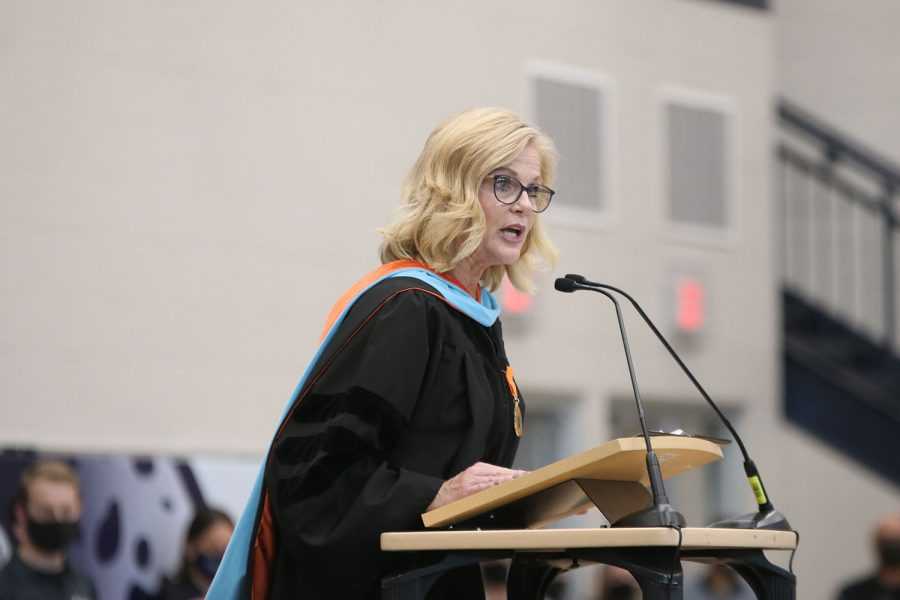 At the podium, principal Dr. Gail Holder welcomes everyone to the graduation ceremony.