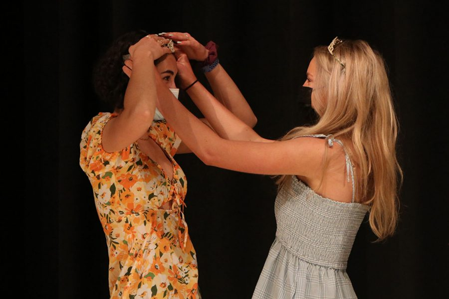 Before the crowning ceremony, seniors Nicole Crist and Molly Ricker adjust their crowns.
