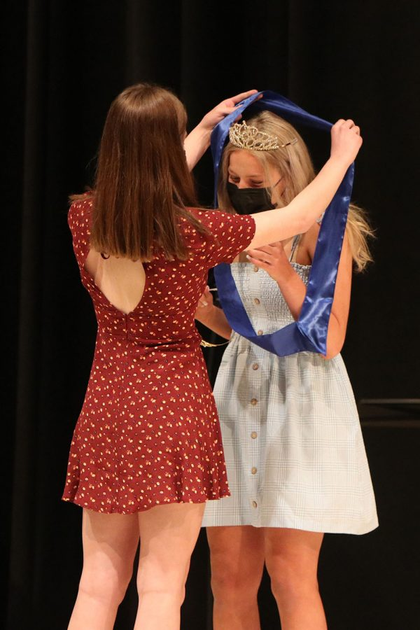 After being announced prom queen, senior Molly Ricker is crowned by student body president senior Ellie Boone.