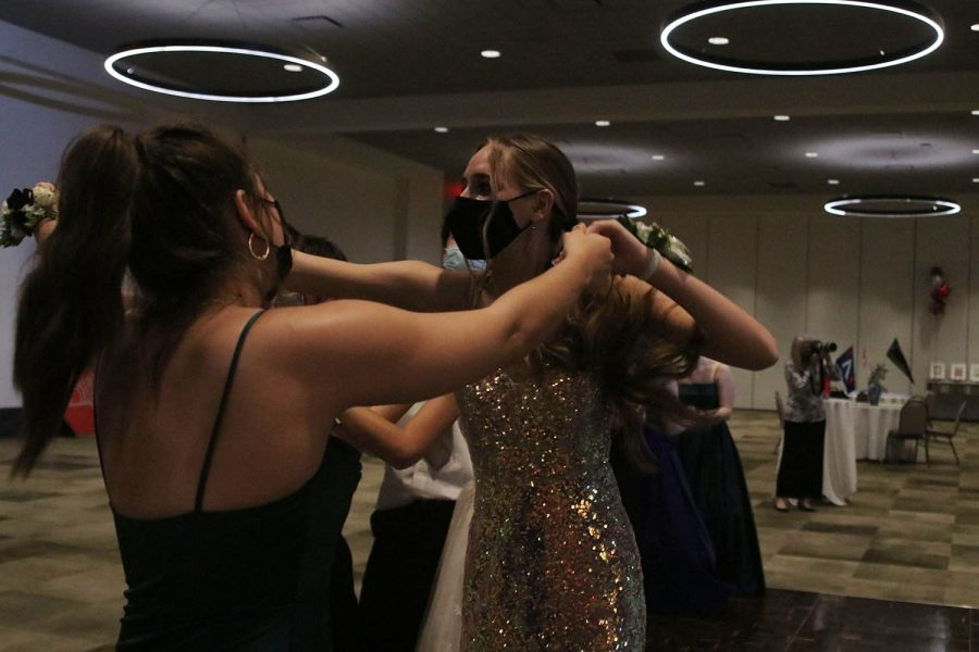 Holding hands with each other, seniors Emily Harris and Addison Kemp sing while dancing.