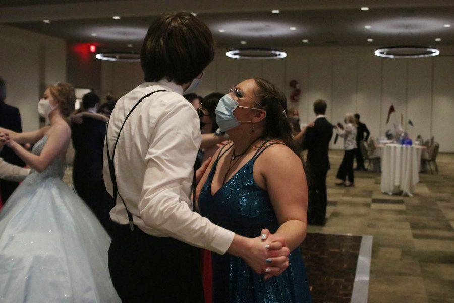 On the dance floor, senior Alexya Cummings dances close to her date.