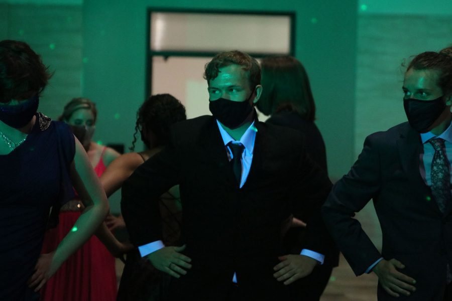"""Hands on his hips, junior Jordan Manning dances to the """"Macarena"""" with his friends."""