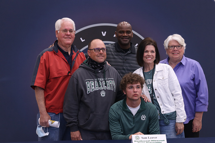 Senior Sam Leaver signs and poses with his family. Leaver will attend Northwest Missouri State University for baseball.