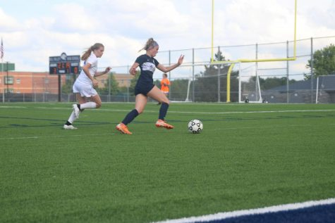 As freshman Kate Ricker goes to shoot for a goal, she makes a move around a defender.