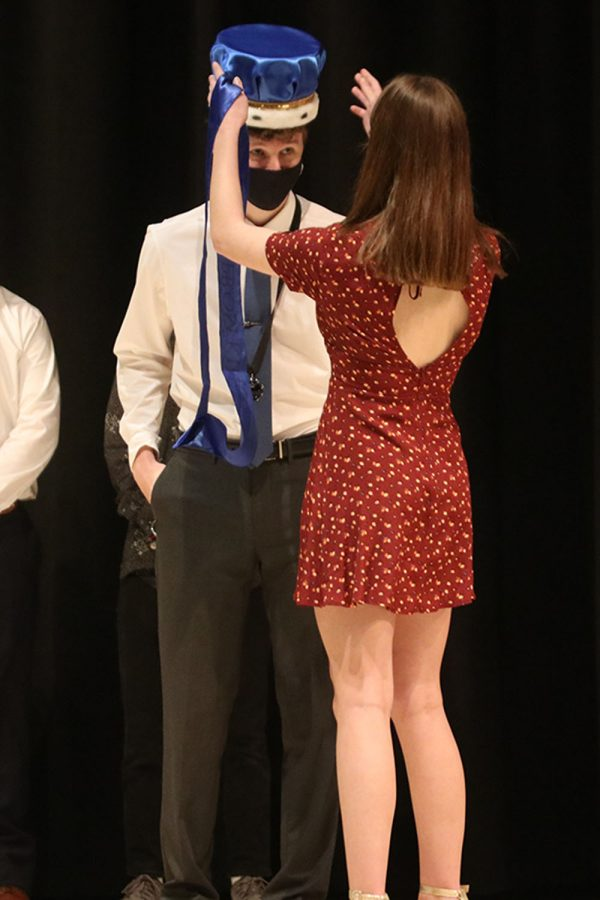 After being announced prom king, senior John Fraka is crowned by student body president senior Ellie Boone.