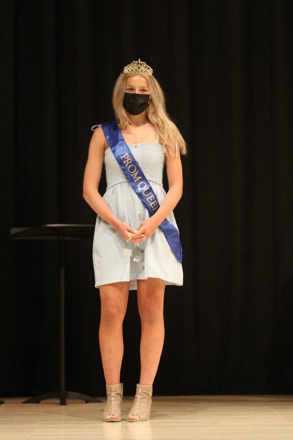 Standing front and center after being announced prom queen, senior Molly Ricker looks out into the audience.