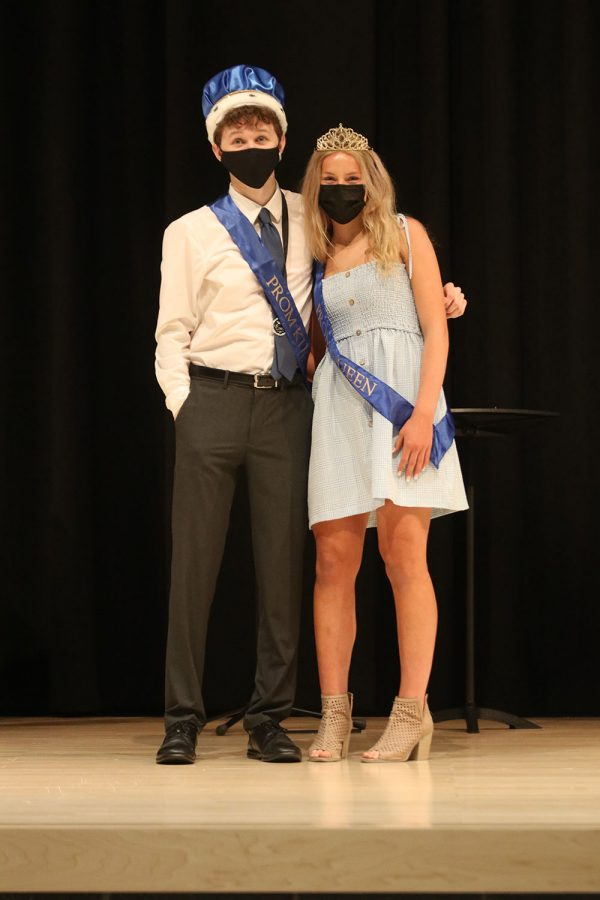 Posing for a picture together, seniors John Fraka and Molly Ricker celebrate being crowned prom king and queen.