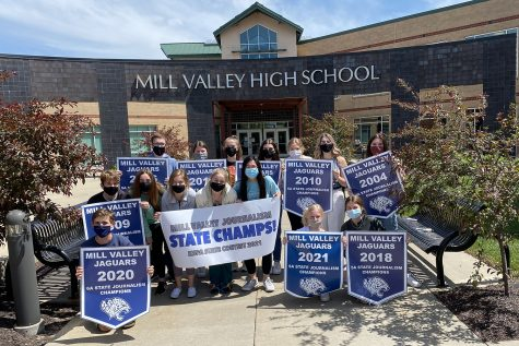 Some members of the 5A state journalism title team celebrate with posters and banners Monday, May 3.