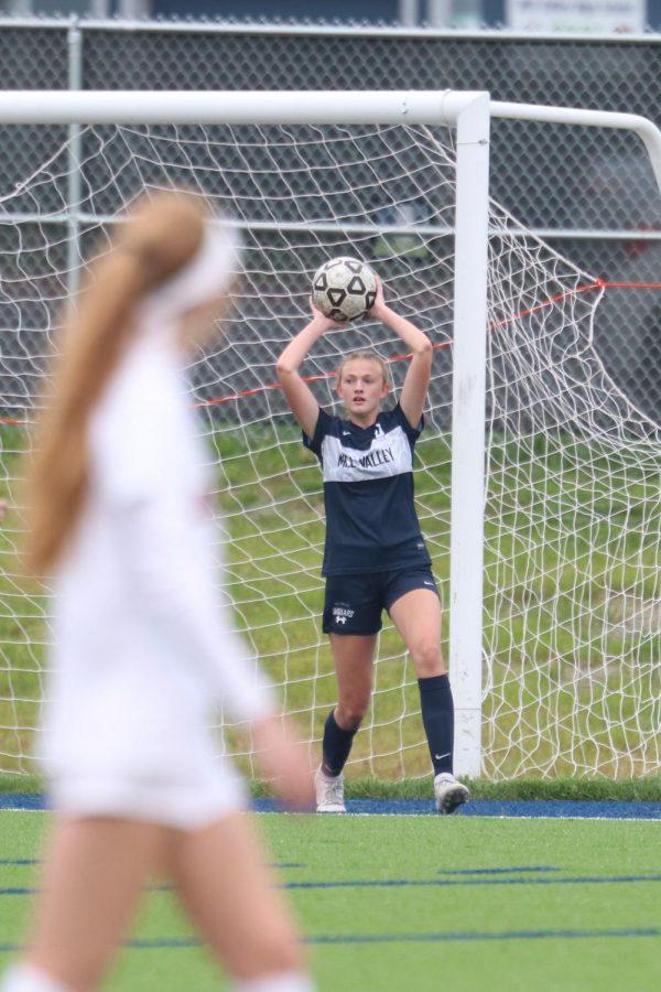 Throwing the ball to a teammate, freshman Julia Coacher gets ready to propel the ball forward.