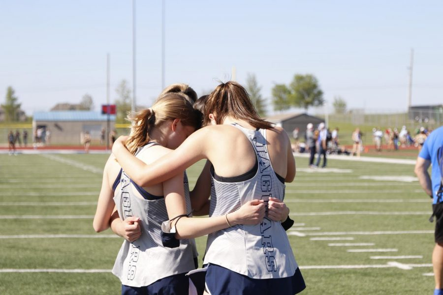 Huddled together, the girls 4x800m relay team exchange words of encouragement before their race is called.