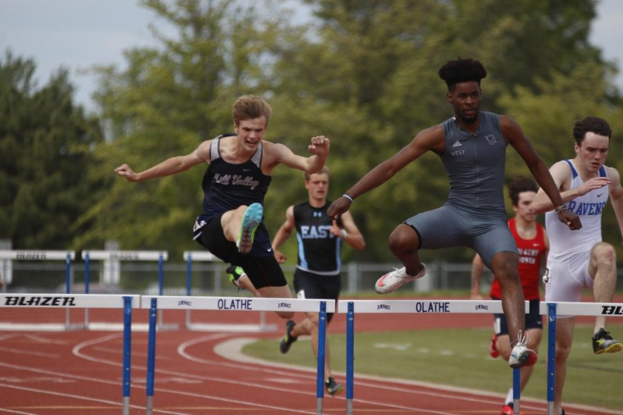 On the second to last set during the 300m hurdle race, senior Leif Campbell eyes the hurdle before clearing it. Campbell took 5th overall in the 300m hurdles and 3rd overall in the 110m hurdles.