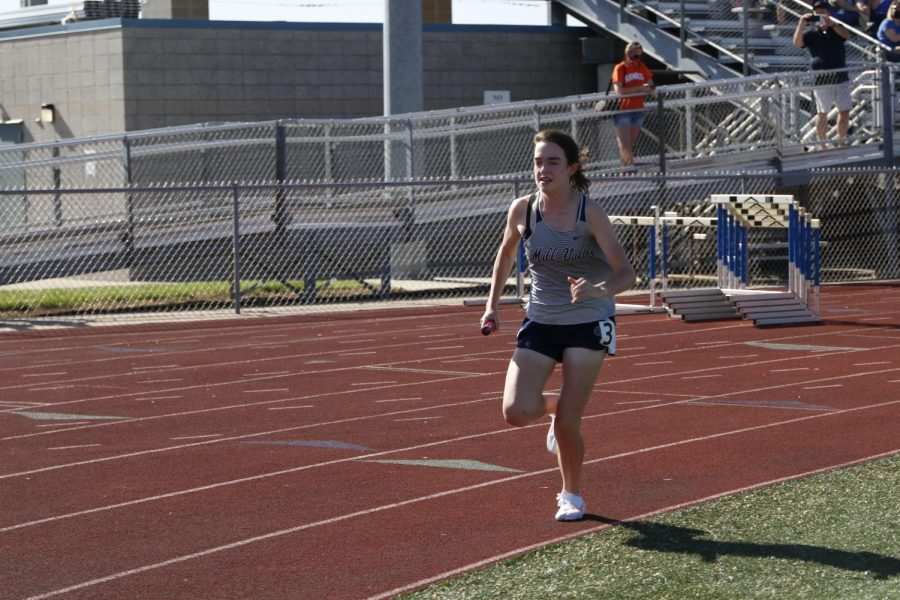Eyes up, sophomore Cree Crawford anchors for the girls 4x800m relay, helping the team get 5th overall.
