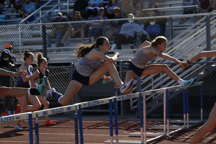 Clearing the next set at the same time, juniors Quincy Hubert and Reece Johnston compete in the 100m hurdles.  Hubert placed 2nd and Johnston placed 3rd.