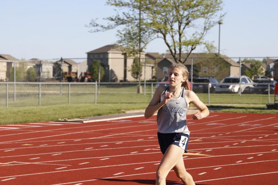 On the last 400 meters of the race, junior Bridget Roy strides out. Roy finished in 5:37 placing 5th overall.