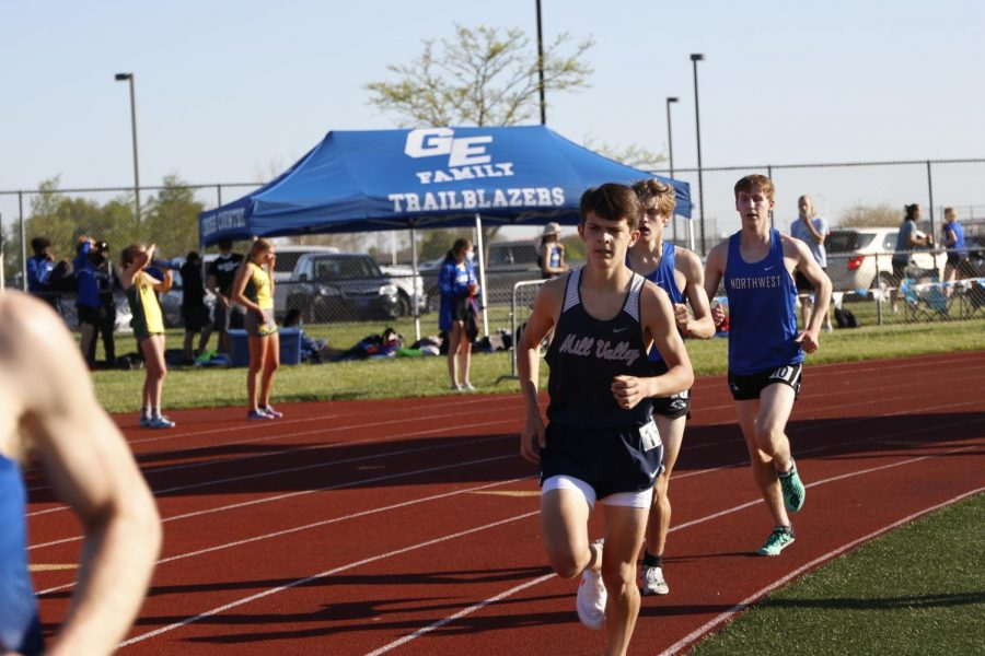 Leading the pack of runners, sophomore Lucas Robins races the 1600m run.