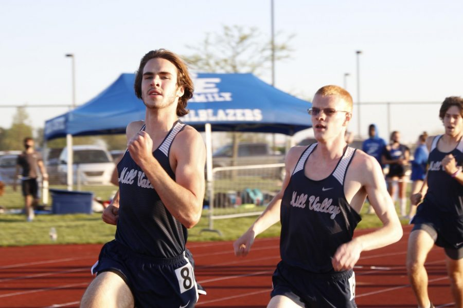 Side by side, seniors John Lehan and Karch Crawford race the 800m run.