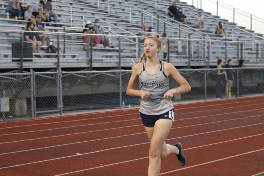 Starting off strong, senior Josie Taylor runs the 3200m race.