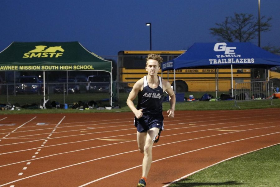 Rounding the bend of the track, senior Carsyn Turpin leads in the second lap of the 3200m race.