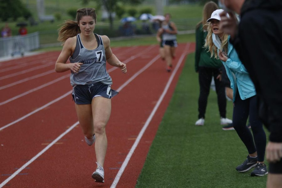 Almost to the finish line, junior Anna Brazil puts in one final sprint for the 1600m race. Brazil came in fifth place with a time of 5:45.