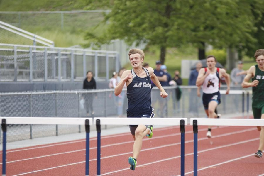 Striding out, senior Leif Campbell focuses prepares to jump over the hurdle in front of him. Campbell qualified for state in the 300m hurdles placing first.