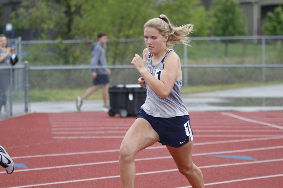After the gun is fired, senior Megan Haymaker pushes off the starting line to race the 800m run.