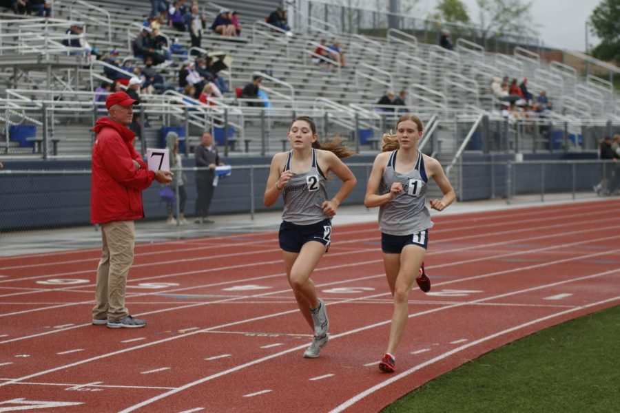 With seven laps to go, freshman Kynley Verdict and junior Katie Schwartzkopf stay with each other during the 3200m run. Both girls qualified for state with Schwartzkopf placing first and Verdict placing second.