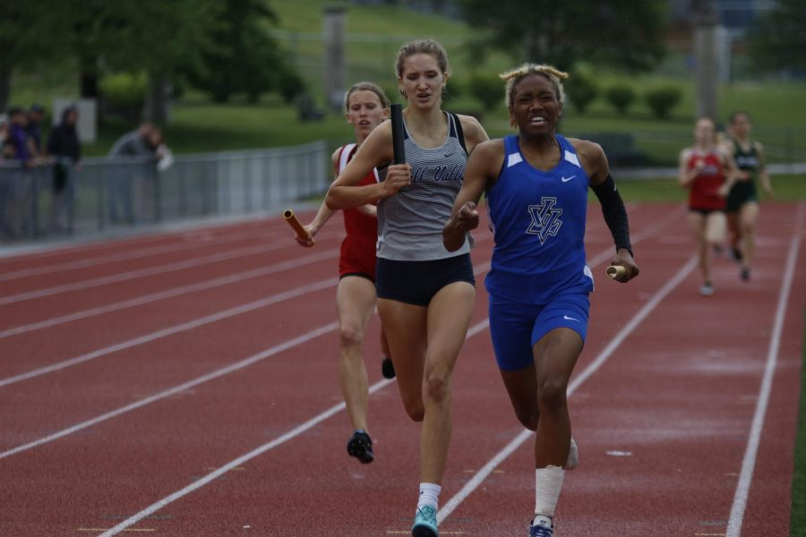 Catching up to an opponent from Leavenworth, junior Reese Johnston tries to maintain her speed to finish her leg of the 4x400m relay. The girls 4x400m relay team placed runner up to Leavenworth High School, thus qualifying for state.