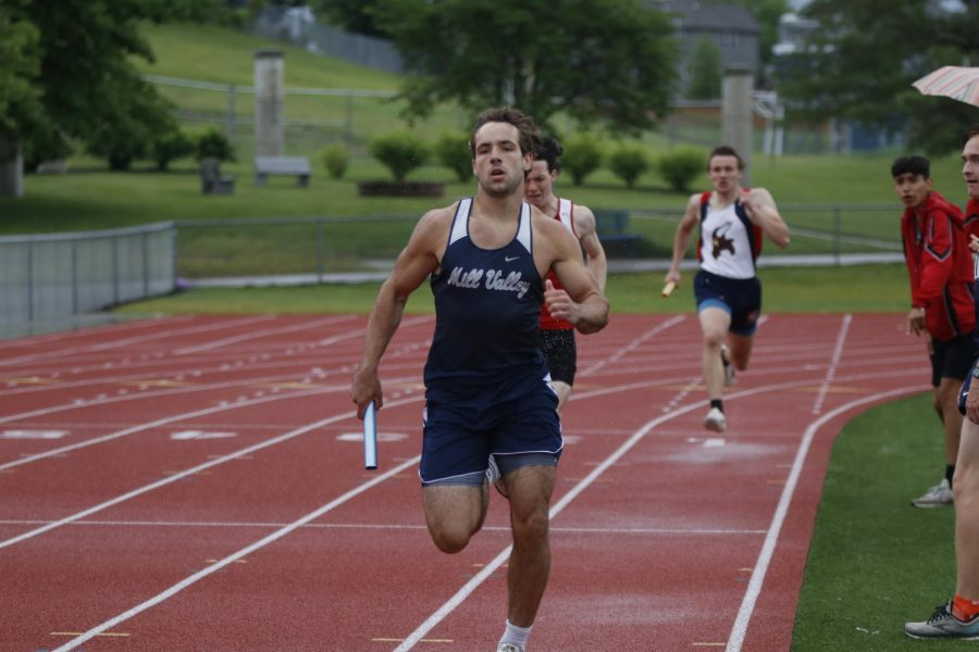 About to hand off the baton during the 4x400m relay, senior Ty Reishus focuses on the track ahead of him. The boys 4x400m relay team placed third, qualifying for state on May 27.