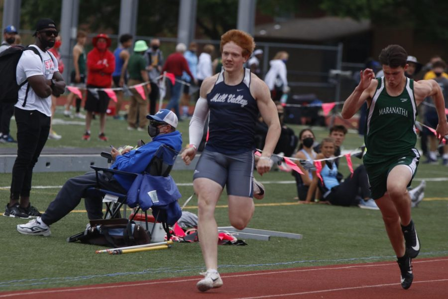 Sprinting down the track, junior Jared Napoli races the 100m dash.