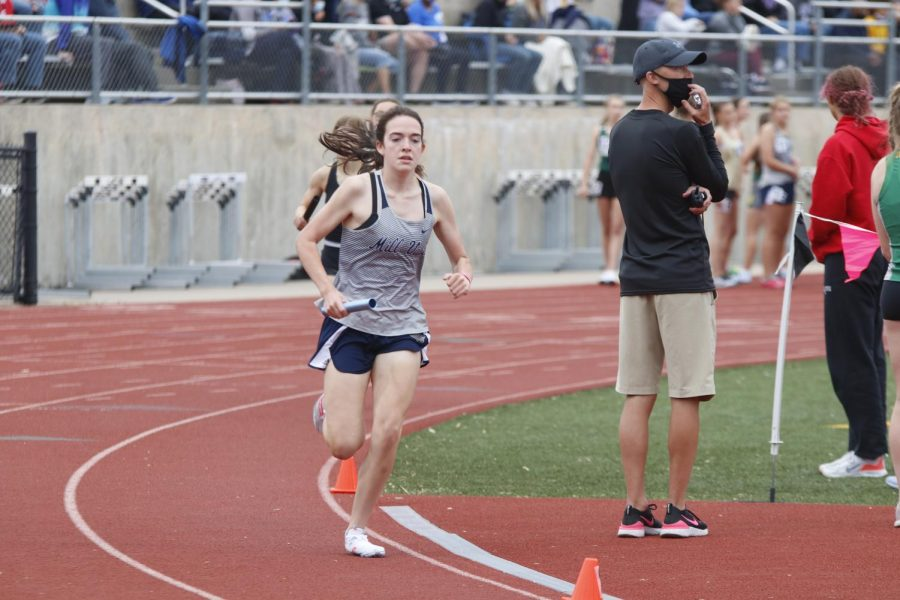 Maintaining her lead, sophomore Cree Crawford runs the third leg of the 4x800m relay. Crawford, along with senior Megan Haymaker and juniors Logan Pfiester and Anna Brazil helped the girls 4x800m relay team place 17th overall.