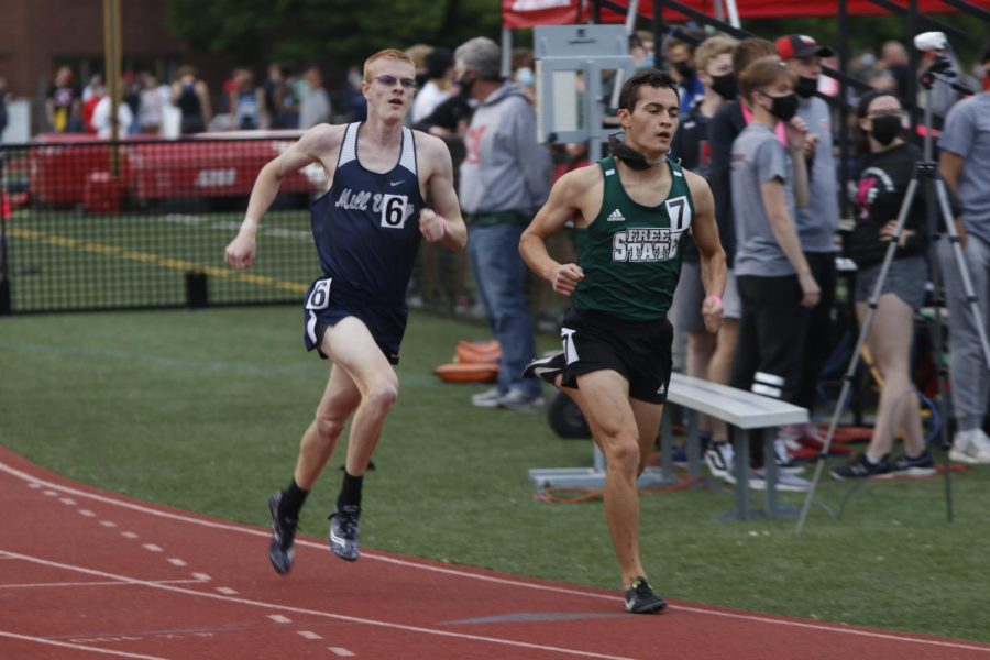 Catching up to Lawrence Free State, senior John Lehan pushes himself to stay with his competitor in the 1600m run. Lehan placed 7th.