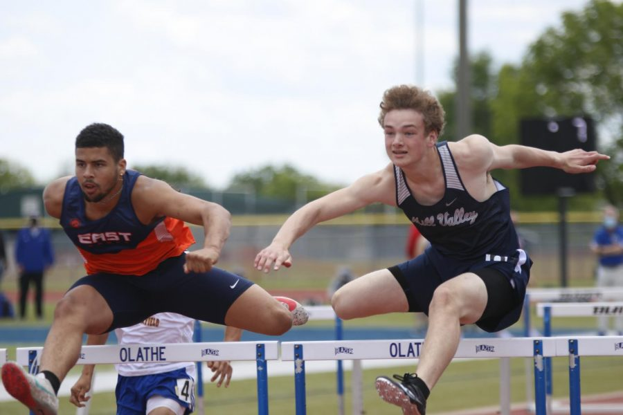 Clearing the hurdle, sophomore Finn Campbell looks ahead toward the final set of hurdles before crossing the finish line. Campbell placed 1st in the second heat of the 110m hurdles with a time of 16.12 seconds.