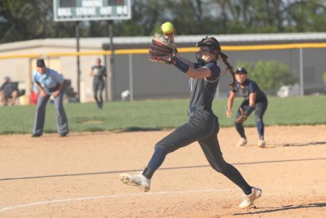 Winding up her arm, sophomore Adysin Hopkins throws the ball toward home plate Thursday, May 6.