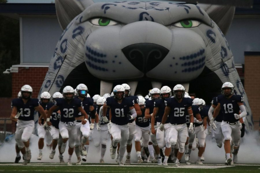 Senior Cody Moore leads the jaguar football team onto the field and into their second home game of the year.