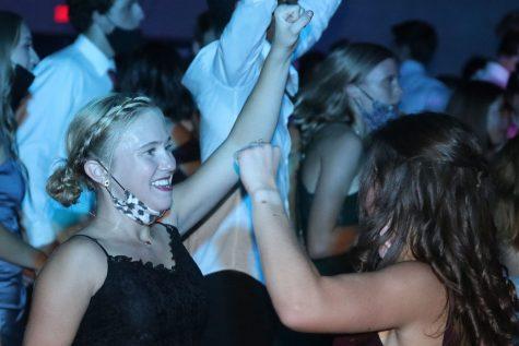 Facing sophomore Ellie Walker, sophomore Jaiden Fisher continues dancing.