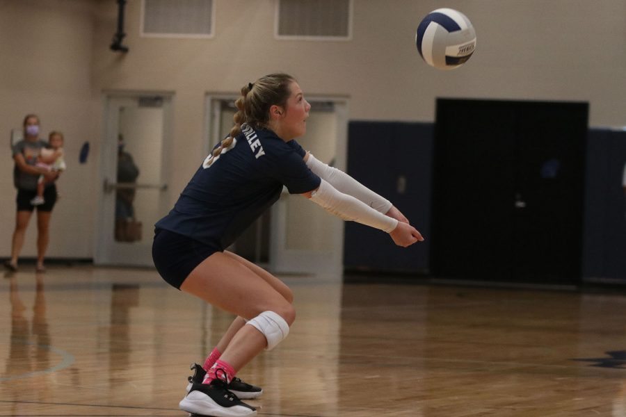 Arms out, junior Sidney Kacsir passes the ball to a teammate.