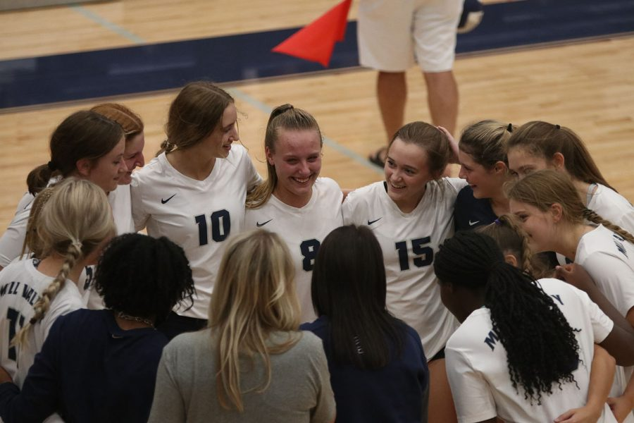 During a time-out, the team huddles together and discusses how they are playing.