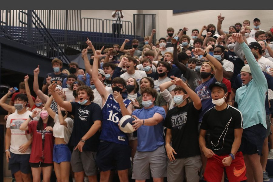 As the team scores the game-winning point, the student section erupts in cheers.