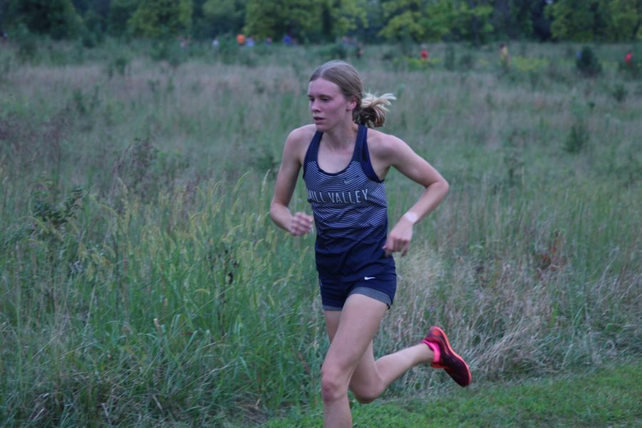Maintaining her lead in race, senior Katie Schwartzkopf eyes the course ahead of her. Schwartzkopf won the girls varsity 5k race with a time of 18:17.